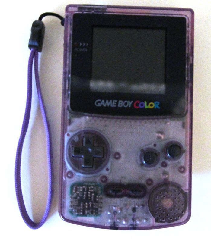 LOT 220. NINTENDO. GAME BOY COLOR. MODELE CGB-001. COLORI TRANSPARENT VIOLET. RECONDITIONNEE. EN L'ETAT.