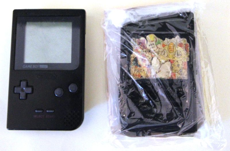 LOT 208. 1 UNITE. NINTENDO. GAME BOY POCKET. MODELE MGB-001. COLORI NOIR. RECONDITIONNEE. MANQUES.  EN L'ETAT.